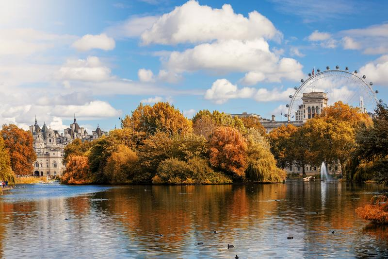 View towards St. James Park in London during autumn, United Kingdom. View towards St. James Park in London during autumn season with golden trees and sunshine stock photography