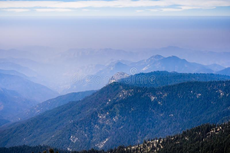 View towards the valley around Fresno covered by the smoke. Drifting from the Canada and northern California wildfires; Sequoia National Park and Sierra Nevada stock images
