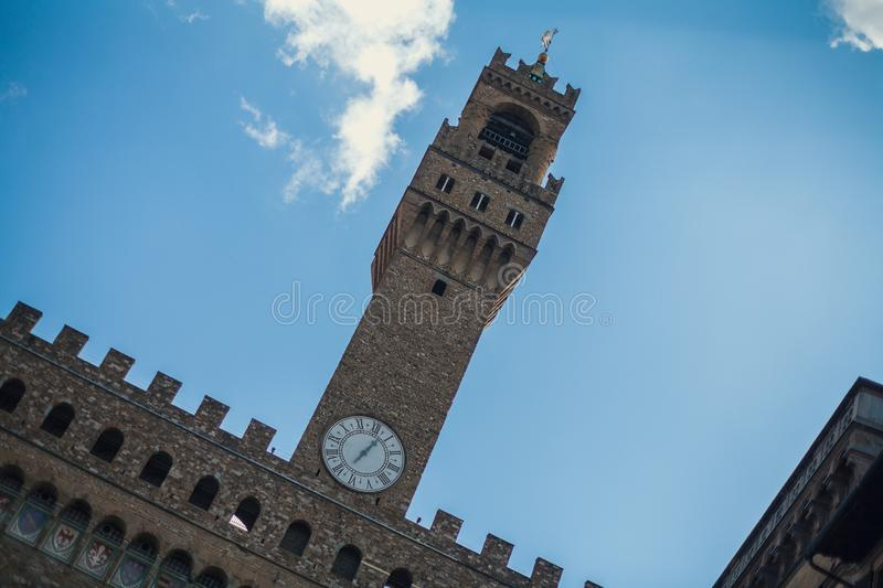 A view of Tower of Arnolfo and his big clock in Signoria Square, Florence, Tuscany stock photography