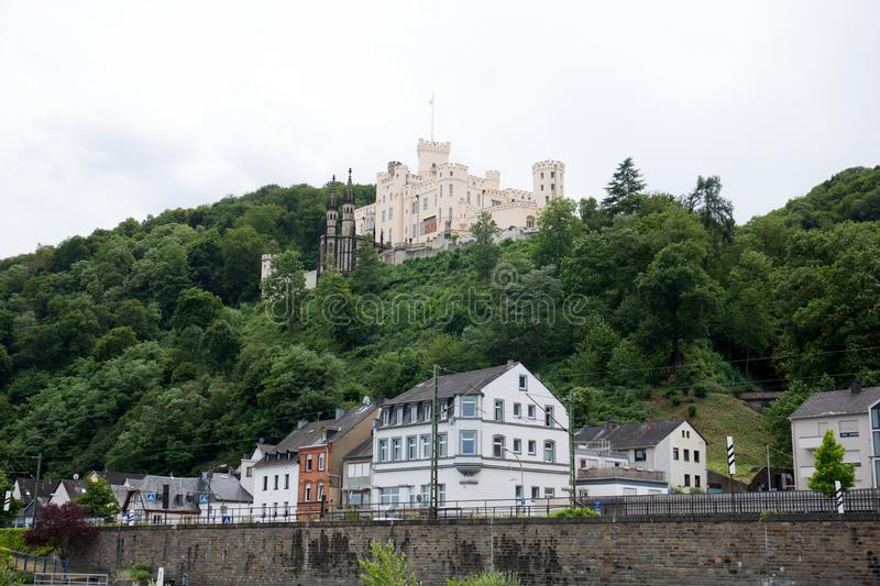 View on a tower and buildings on a hill at the rhine river in Koblenz rhine and surrounding. Photographed during a sightseeing tour on a ship on the rhine at a stock image