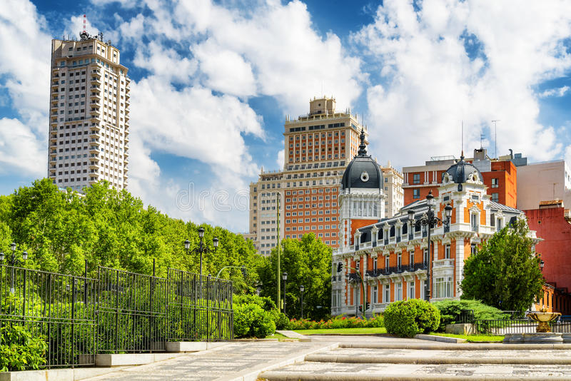 View of the Tower of Madrid (Torre de Madrid). And the Spain Building (Edificio Espana) on the blue sky background with white clouds in summer. Madrid is a royalty free stock image