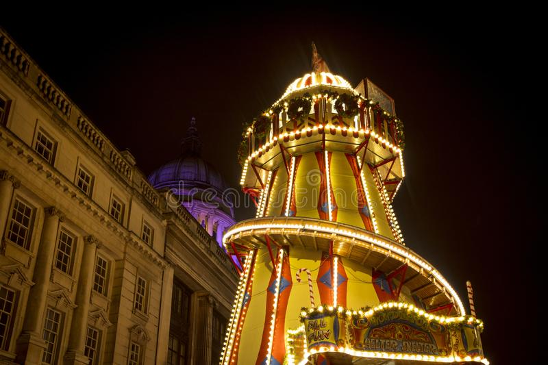 A view of the town hall and helter skelter at Nottingham Christmas Market in the Old Market Square, Nottingham, Nottinghamshire - royalty free stock photos