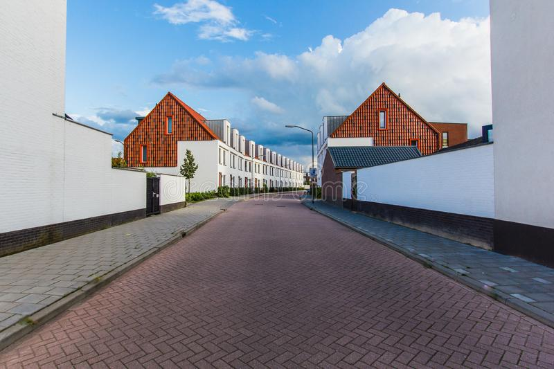 View town Oosterhout Netherlands, Europe, new small houses, resi. Street perspective with facades of new small houses, residential area town Oosterhout royalty free stock photos