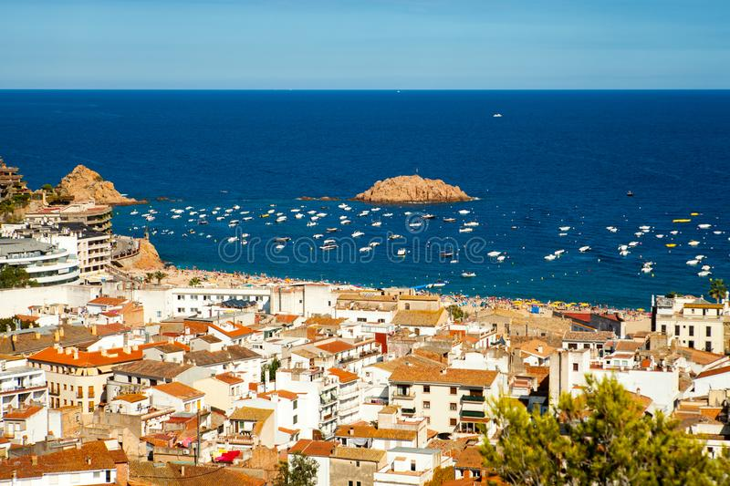 View of the town of Tossa de mar, city on the Costa Brava. Buildings and hotels on the hill. Amazing city in Girona, architecture and beach of Catalonia royalty free stock images