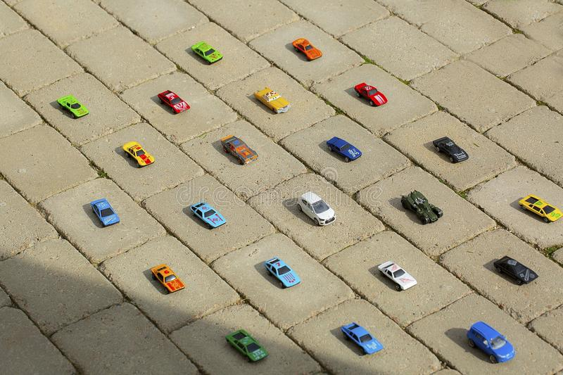 View of toy cars models carefully put each on it`s place by child. Children concept. royalty free stock image