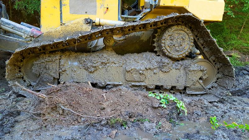 Track of bulldozer. View on the track of bulldozer on mud royalty free stock image