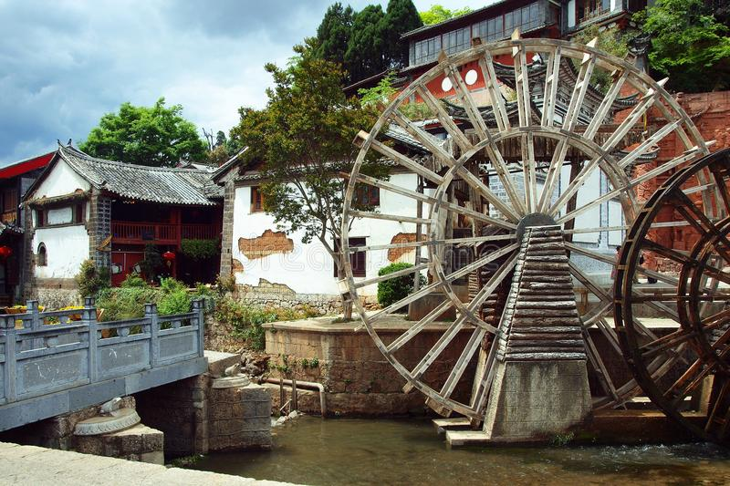 View of traditional chinese buildings in lijian ,yunnan province ,china. View of traditional chinese buildings with water wheel in lijian ,yunnan province ,china royalty free stock photo