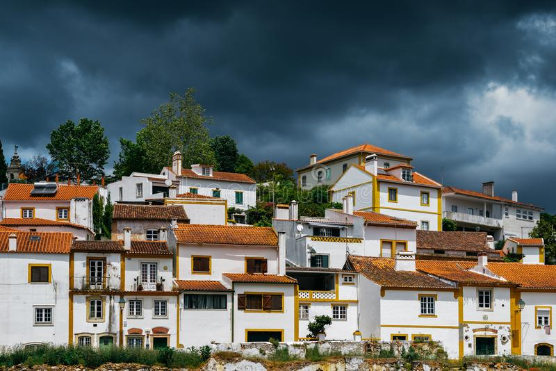 Traditional houses in Constancia, Portugal. View of traditional limestone cozy yellow and white houses at Constancia in the Santarem District of Portugal royalty free stock photos