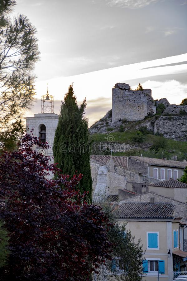 View on traditional medieval houses and castle ruines in Provence, South of France, vacation and tourist destination royalty free stock images