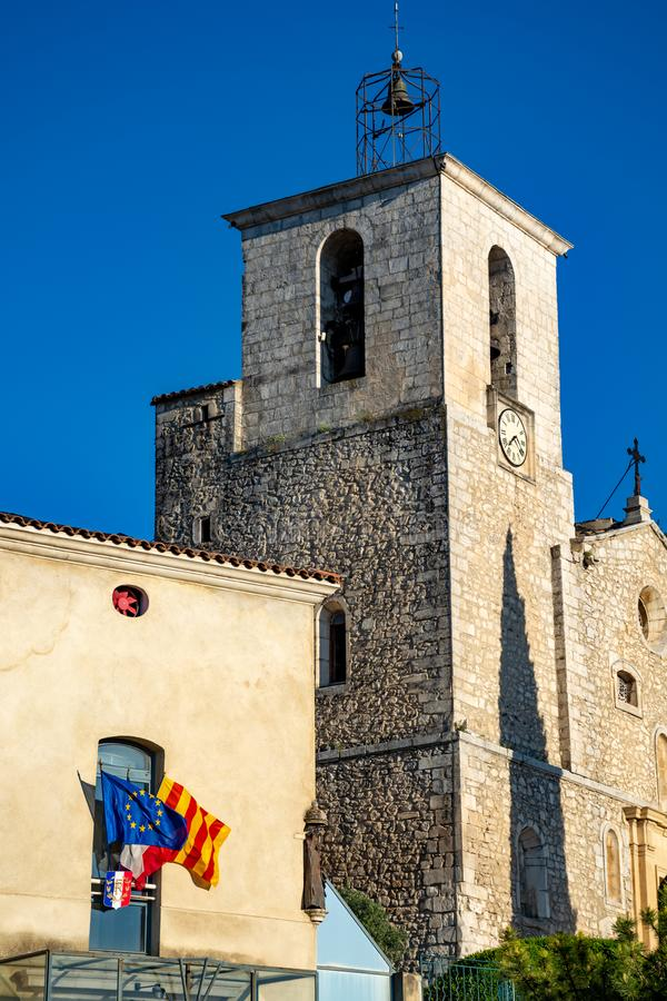 View on traditional and medieval houses and church tower in Provence, South of France, vacation and tourist destination royalty free stock photos