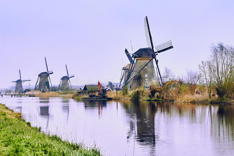 View of traditional 18th century windmills and water canal in Kinderdijk, Holland, Netherlands royalty free stock photo