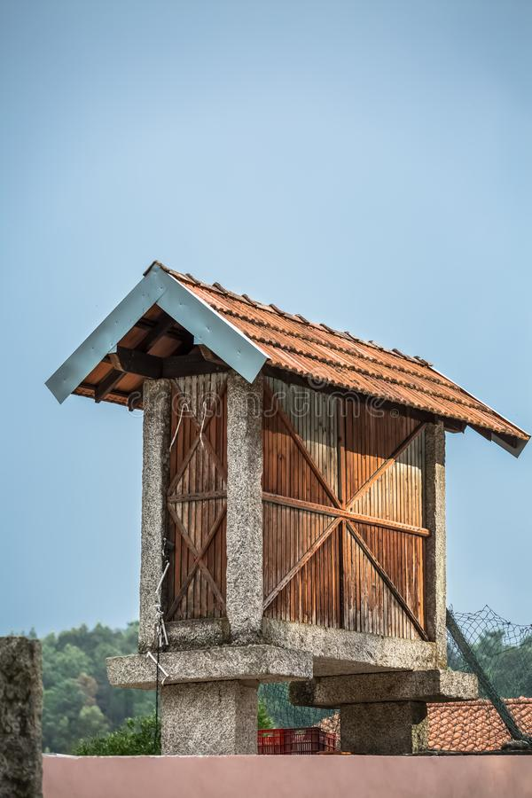 View of traditional warehouse to store corn, typical in Portugal.  stock photos