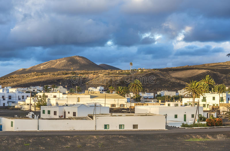 Download View On Traditional Whitewashed Village With Volcanos On The Bac Stock Image - Image: 85635351