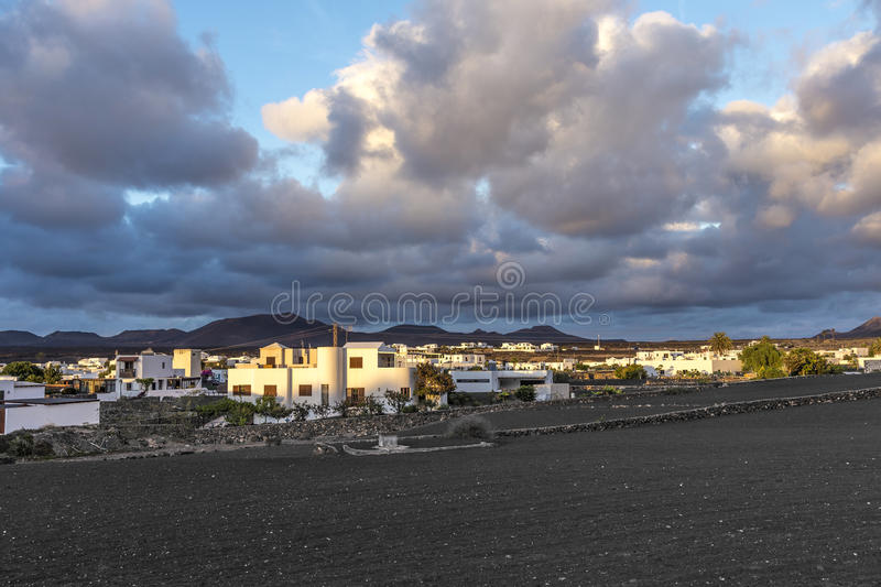 Download View On Traditional Whitewashed Village With Volcanos On The Bac Stock Image - Image of outside, village: 85635369