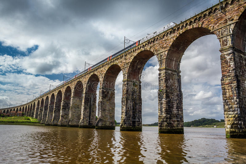 View of the train in old stone bridge stock image