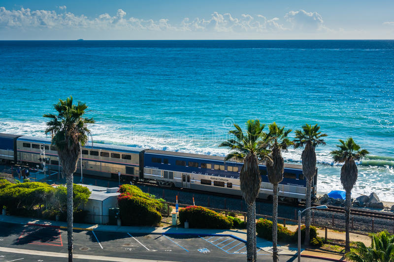 View of a train on a railroad track along the beach royalty free stock photography