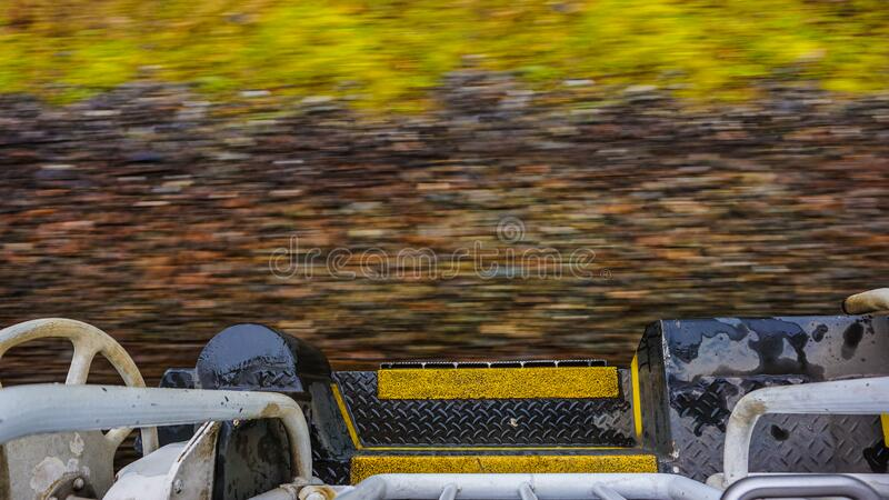 View of train track from the boarding platform of a speeding locomotive royalty free stock photo