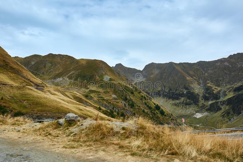 View of Transfagarash highway and valley in mountains of Romania. Tourist view mountain road. Autumn mountain landscape stock photos