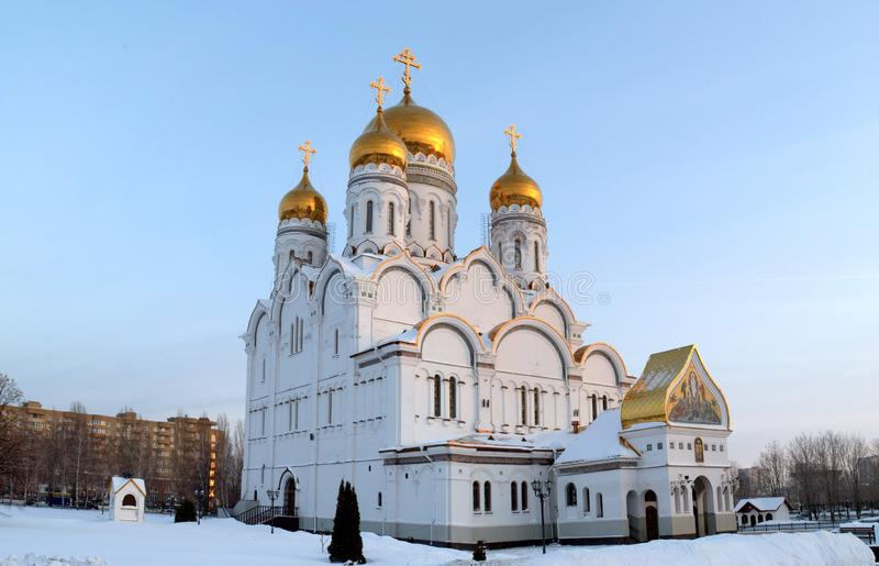 View of the Transfiguration Cathedral in the city of Togliatti on a winter evening in the light of sunset. Panoramic shot stitched from several frames taken on stock image