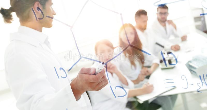 View through the transparent Board. a scientist makes a report. royalty free stock photos
