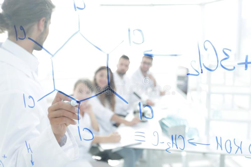 View through the transparent Board. a scientist makes a report. The concept of education royalty free stock photo