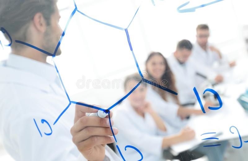 View through the transparent Board. a scientist makes a report. The concept of education royalty free stock photos