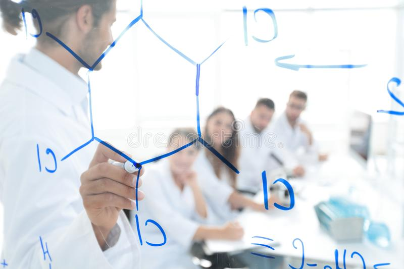 View through the transparent Board. a scientist makes a report. stock photography