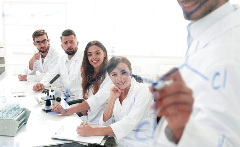 View through the transparent Board. a scientist makes a report. stock photo