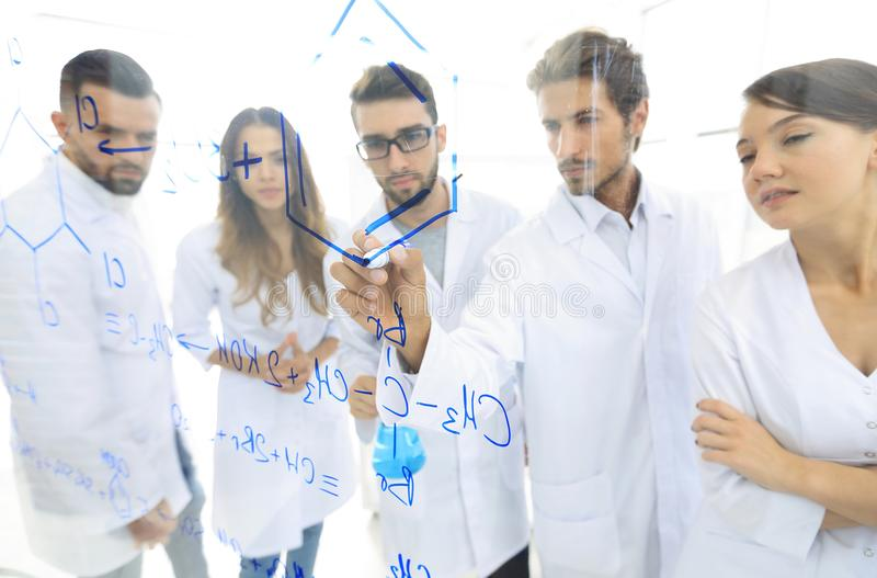 Download General-view Seen Trough A Transparent Board In A Chemistry Lab Of People Analyzing Information Stock Photo - Image of innovation, chemist: 108907054