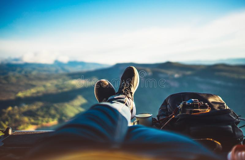 View trekking feet tourist backpack photo camera in auto on background panoramic landscape mountain, vacation concept, foot photo. Graph hiking relax in auto royalty free stock images
