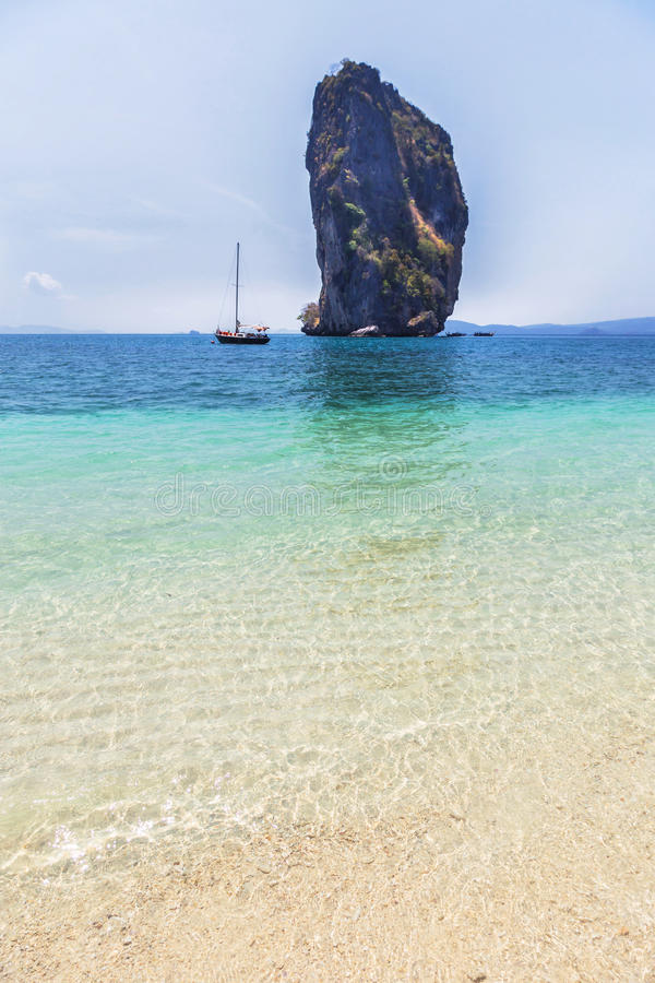 View of tropical beach and clear water and blue sky with limestone rock background at po da island , krabi Thailand royalty free stock images
