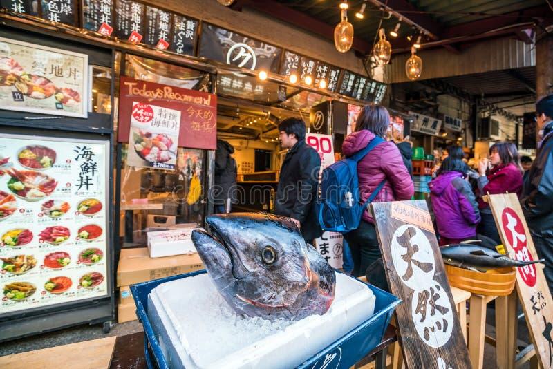 View of Tsukiji fish market. TOKYO,JAPAN - DEC 9 : View of Tsukiji fish market with retail shops and restaurants carter in Tokyo on December 9, 2016 royalty free stock photos
