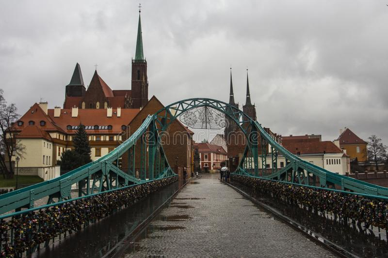 View of Tumski Bridge and ancient churches in Wroclaw. Poland.  royalty free stock photo