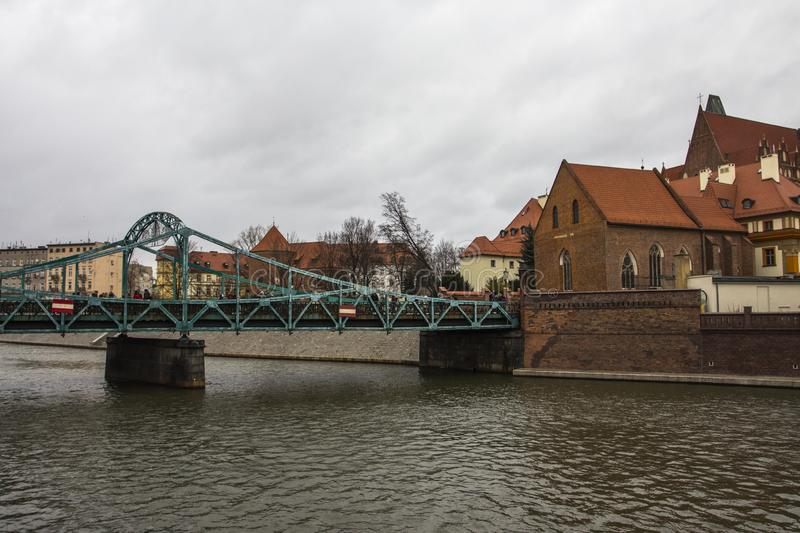View of Tumski Bridge and ancient churches in Wroclaw. Poland.  royalty free stock photos