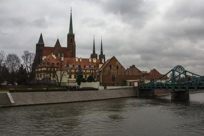 View of Tumski Bridge and ancient churches in Wroclaw. Poland.  stock photography