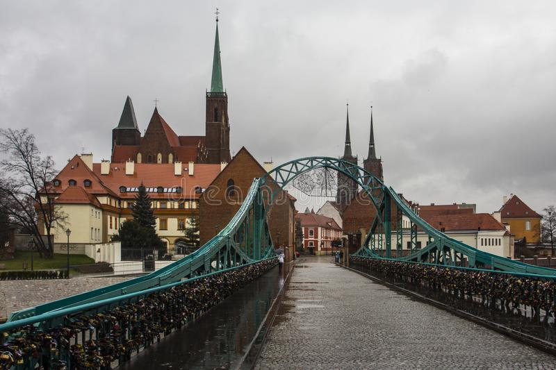 View of Tumski Bridge and ancient churches in Wroclaw. Poland.  stock image
