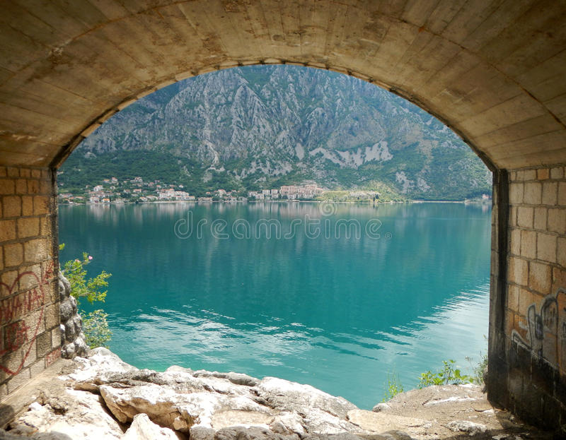 The view from the tunel by the sea in adriatic sea in mintenegro. Under the bridge, the sea view in montenegro royalty free stock photo