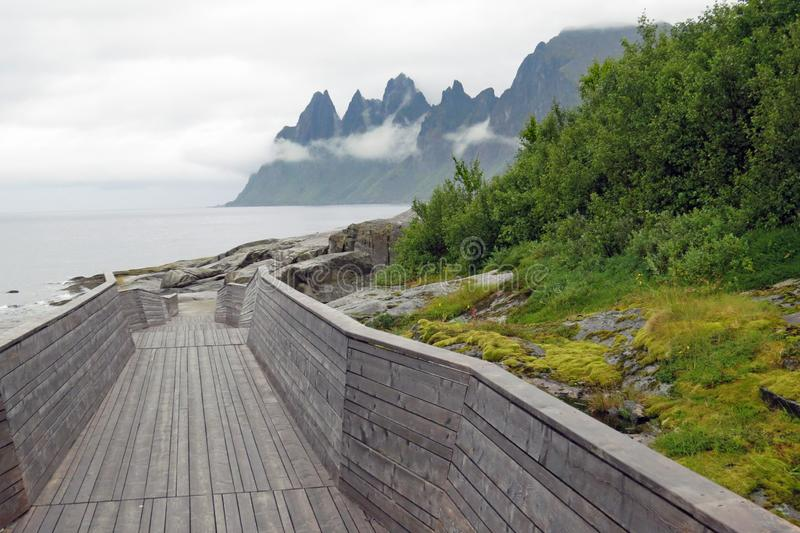 View on the Devil`s Jaw / Devil`s Teeth, mountain chain from the Tungeneset picnic place on Senja, Ersfjord, Norway, Europe. A view from the Tungeneset stock image