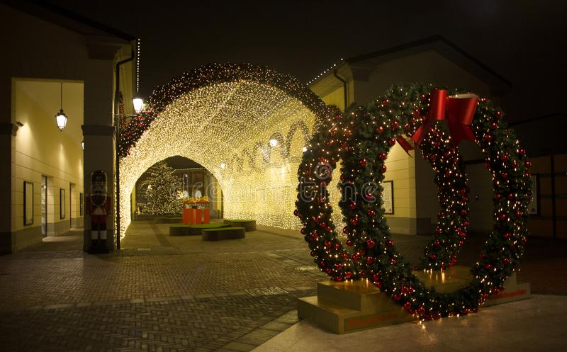 View of a tunnel of lights in `Serravalle Outlet` shopping center on Chistmas time, near Milan, Italy royalty free stock photo