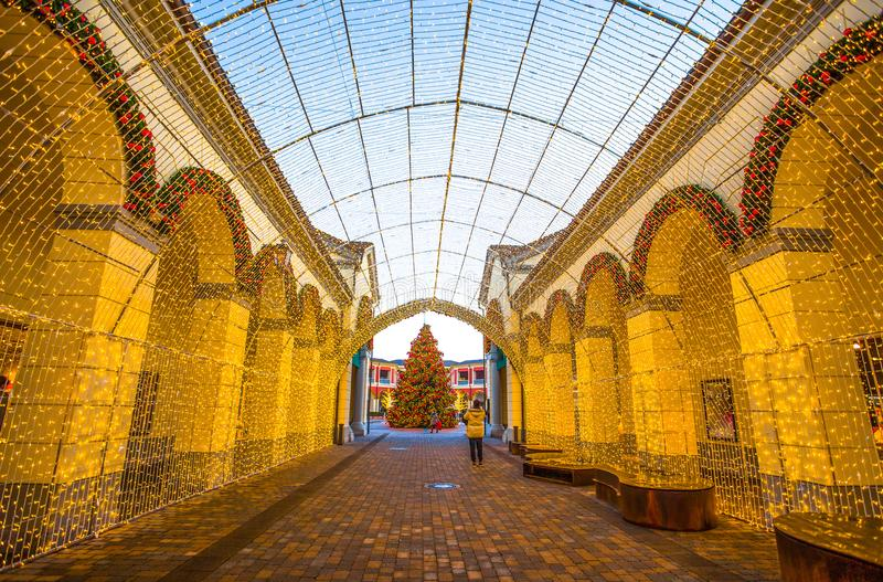 View of a tunnel of lights in shopping center on Chistmas time, Italy stock image