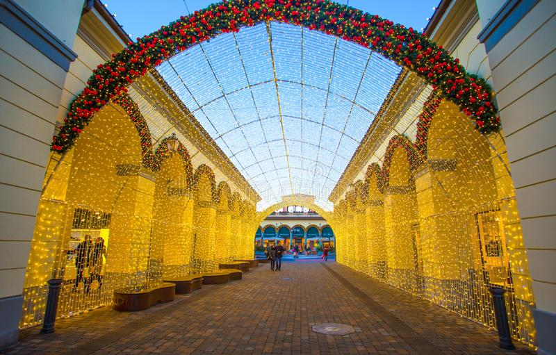 View of a tunnel of lights in shopping center on Chistmas time., Italy royalty free stock photos