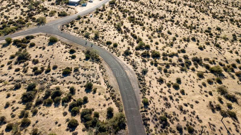 View of Aerial View Of McDowell Regional Park Near Phoenix, Arizona. View of two bicyclists on the road and desert landscape in McDowell Regional Park near stock image