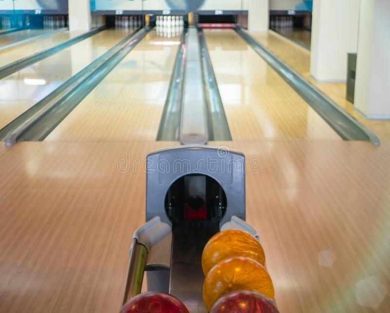 View on two empty lanes tracks at bowling entertainment club and a stand with balls. ready for competition or championship stock photo