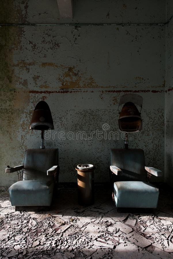 Derelict Hair Dryers - Abandoned Westboro State Hospital - Massachusetts. A view of two vintage / retro derelict hair dryers at the abandoned Westboro State stock photos