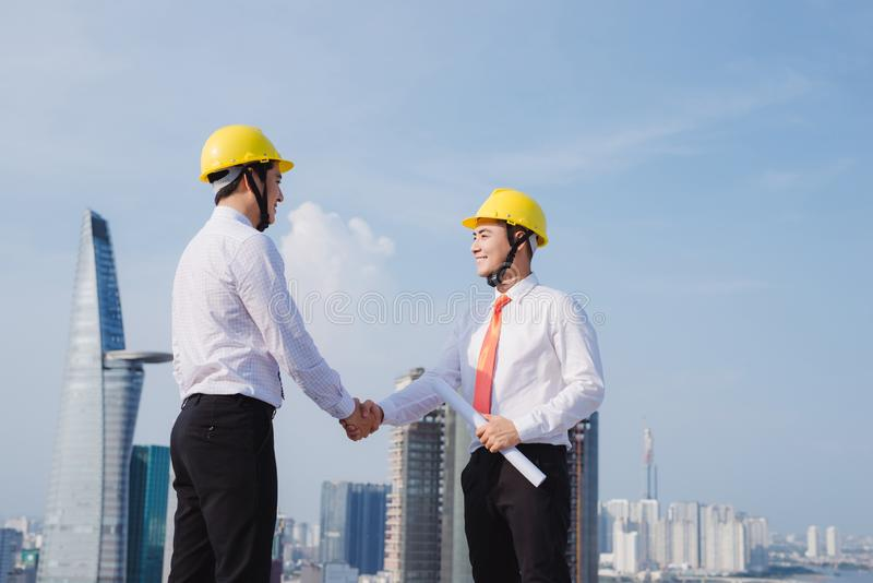 View of Two workers working outside with a tablet on a construction site stock photo