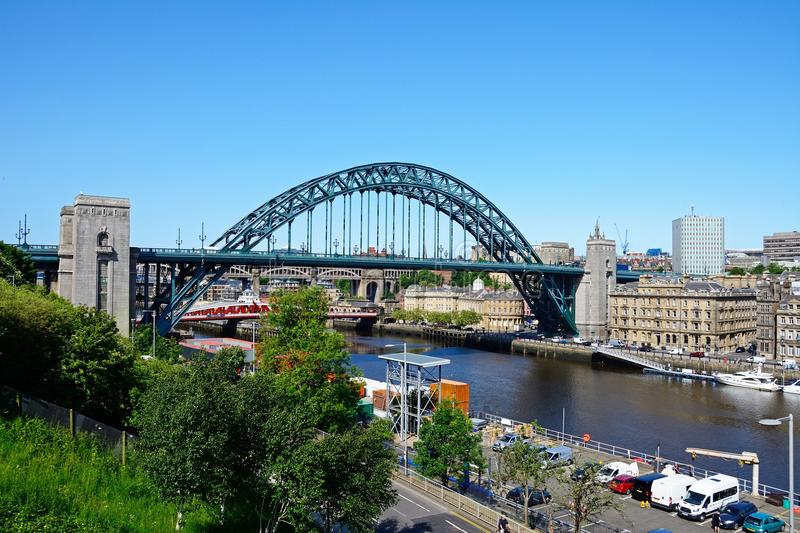 The Tyne Bridge and river Tyne, Newcastle upon Tyne. View of the Tyne Bridge across the River Tyne with city buildings to the rear seen from the Gateshead side royalty free stock photo