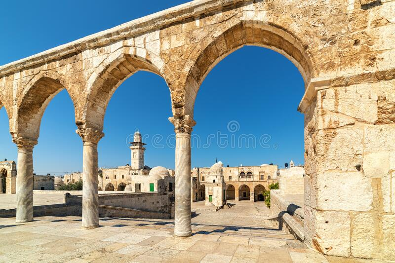 Ancient stone arches and minaret in Old City of Jerusalem. stock photo