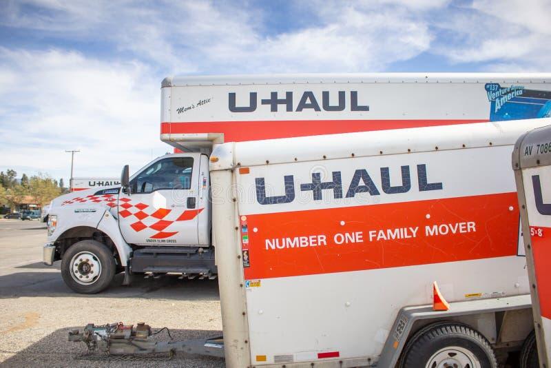 U-Haul trucks. A view of the U-Haul logo on one of its rental trucks and a rental trailer stock photo