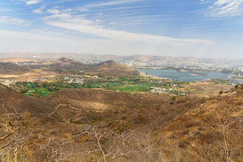 View of Udaipur city and Fateh Sagar lake from Monsoon Palace. India royalty free stock photo