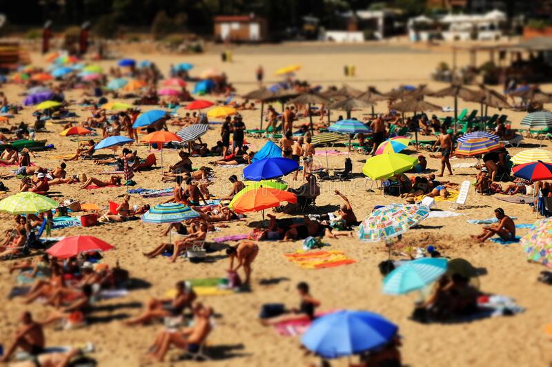 View of Umbrellas and People on a Crowded Beach royalty free stock images